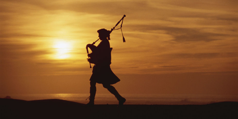 landscape-1504084805-bagpiper-against-sunset